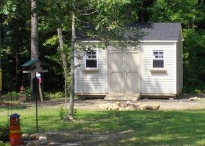 storage sheds built on site, sheds built in woods, shed financing, vinyl storage shed, shed with horizontal siding