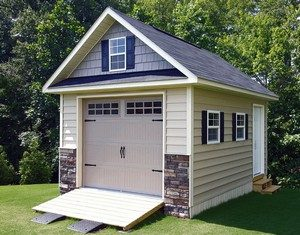 custom sheds built on site,shed with high pitch, shed with eyebrow, shed with stone accent, raleigh, nc